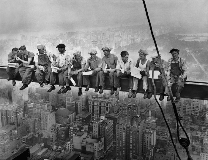 workers eat lunch atop a skyscraper in 1932