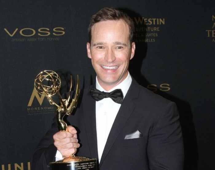 Mike Richards with an Emmy