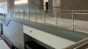 Lewisville High School's stairways and balconies now feature Banker Wire stainless-steel mesh.