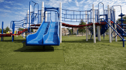 Blue Springs School District improved playground safety for their students, as well as lowered overall maintenance costs, with an artificial grass playground.