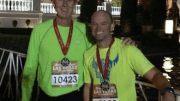 Publisher John Riester and Jason Waller (right) ran in the Rock-n-Roll Half Marathon in Las Vegas.