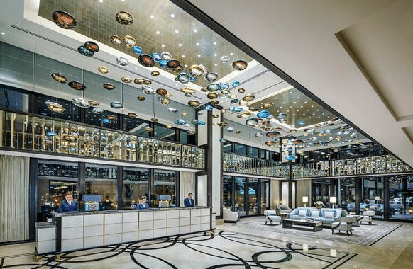 The hotel lobby features glass art installations that reference the grandeur of The Langham, London, while celebrating the modern Mies van der Rohe building and city of Chicago.