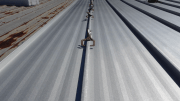 McElroy's 238T symmetrical standing seam system was installed over the existing roof with the aid of McElroy's patent-pending 238T Retrofit Clip, a 3 1/2-inch standoff clip that elevates the new roofing system to the top of the existing panels.