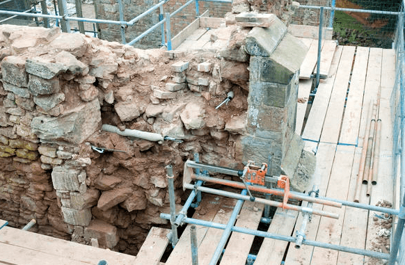 A diamond drill helped to insert the steel anchors into the building.