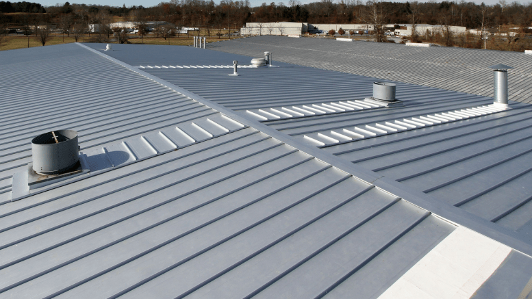 Here is an installed 238T recover over R-panel by Titan Roof that utilizes McElroy Metal's transverse panels behind curbs to provide long term performance.
