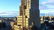 Walker Tower, a former telephone switching building, rises high above its New York City surroundings with stunning 360-degree city views. Today, it offers appealing, high-end residences.
