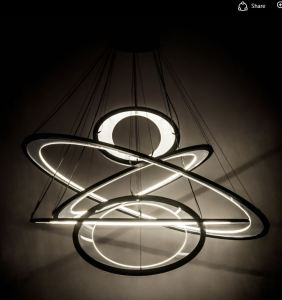 The Anillo Ellipse 5 Light Cascading Pendant features adjustable elements of ambient light including five elliptic spectral halos which appear to rotate in space and create a visual effect.