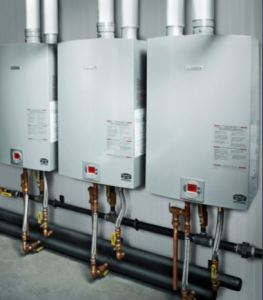 The leaking gas-fired units are replaced with Bosch Therm 1210ESC condensing tankless water heaters with no interruption of service.