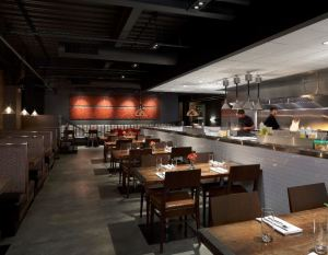 The open-kitchen concept showcases Element's approach to contemporary, farm-to-table comfort food.