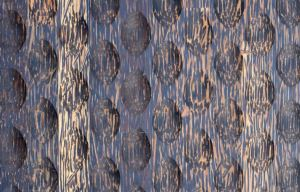 The panel features a palm wood design of offset, ovalesque carve-outs.
