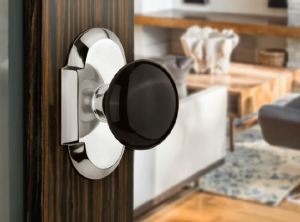 The Black Porcelain Knobs are kiln-fired and mounted on a brass backplate.