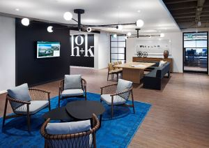 As more people work from home after office hours or as telecommuters, the comforts they are accustomed to in their residences are emerging in the workplace.