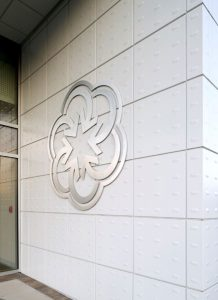 The metal panels create a focal point around the entrance of the building to welcome visitors to the center.