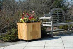 The outdoor speaker is built into the cedar-clad North Dakota architectural planter.