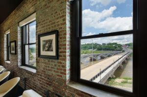 Elements of the original Dan River Research Building are incorporated into the exhibits and features of the conference room, which overlooks the Dan River.