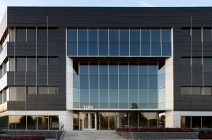 Contrasting Dri-Design Wall Panels transform the 30-year-old, 4-story office building into a modern lease option.