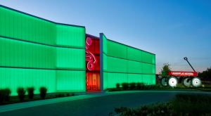 Dyna Drum HO and Dyna Flood QA fixtures illuminate the front of the building with rich colors day and night.