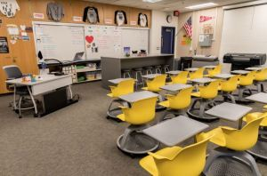 Tangram Interiors restructures a fine-art, black & white photography classroom and darkroom into a multimedia photography and marketing classroom and studio.