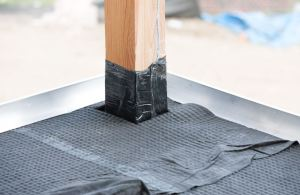 The dimpled drainage core and filter fabric of the drain mat helps protect entry points from potential moisture penetration into buildings.