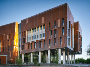 Arizona State University's Biodesign Institute C implements thousands of copper panels featuring eight different configurations of perforation. These perforation patterns were carefully calibrated and positioned to minimize solar heat gain, optimize daylighting and visual comfort, and provide unobstructed views of the campus. PHOTO: Nick Merrick