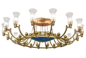 The Kahe Chandelier features 16 tapered hurricane shades with a frosted glass design on a clear glass background.