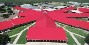 The original roof is replaced with 233,335 square feet of symmetrical standing seam metal roofing in PVDF Brite Red from McElroy Metal.