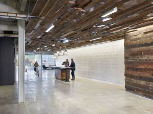 Reclaimed wood is used in the entryway of the space and above the wine bar, connecting the office with the history of the Mid-Atlantic region while providing acoustical benefits.