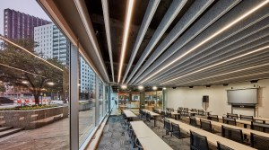 To mitigate reverberation issues and address the lighting needs in the first-floor training room and event space, Omniplan selects the Seem 1 Acoustic luminaire and baffle system.