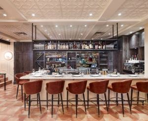 Decorative ceiling panels over this bar, the main dining area, the antipasto bar and beyond, help to unify the space.
