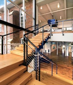 Salvaged materials were reused throughout the project. Of note is a new monumental steel STAIR, utilizing 200-year-old beams as treads and platforms.
