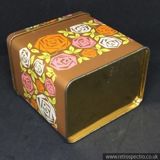 Storage tin with flower pattern