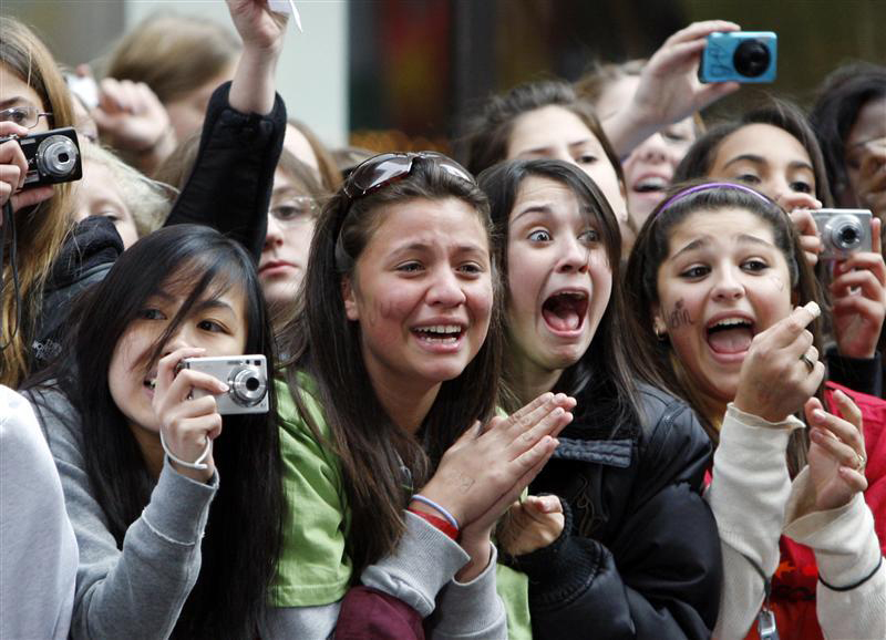 Fans of singer Justin Bieber scream as he performs on NBC's Today Show in New York