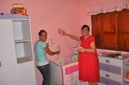 Ruth and grandma Becky work on the baby's room!