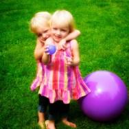 Becca gives Anna a hug.