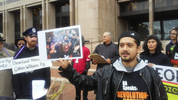 """Noche Diaz questions a man dressed as a pig named """"Chief Pig Calvin William"""" in front of the Justice Center."""