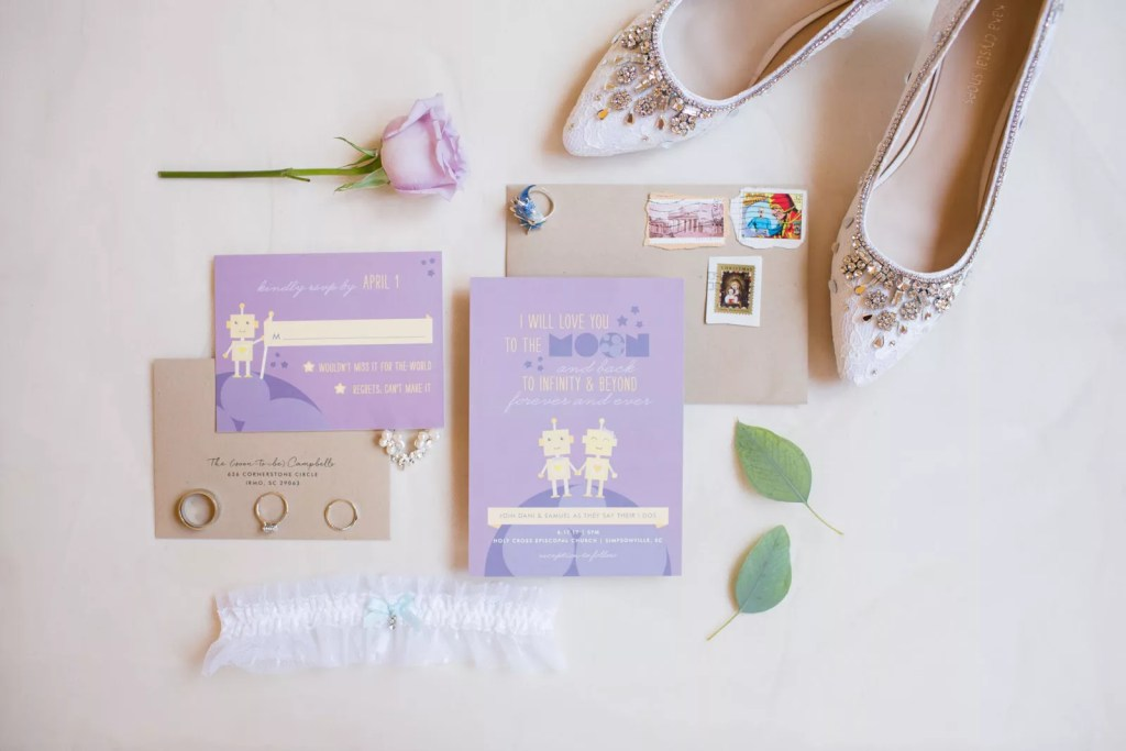 purple robot invitation suite paired with shoes and floral details