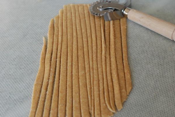 Cutting spaghetti from the pasta dough