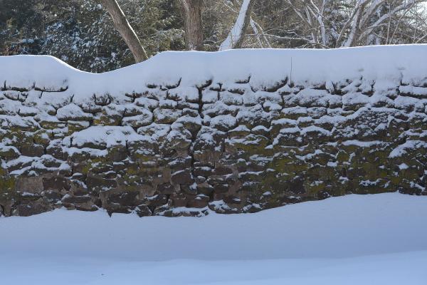Snowy stone wall