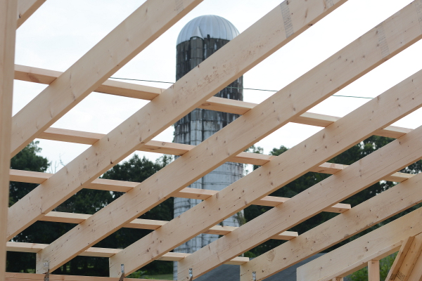 view of silo through garage roof beams