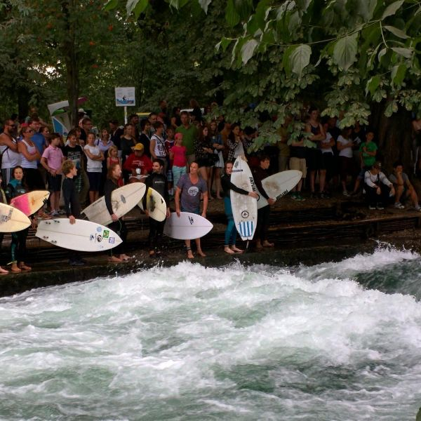 Watch surfers on the Eisbach in Englischer Garten.
