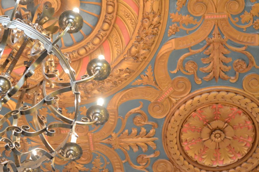 The ornate ceiling of the HOTEL DU PONT's lobby.