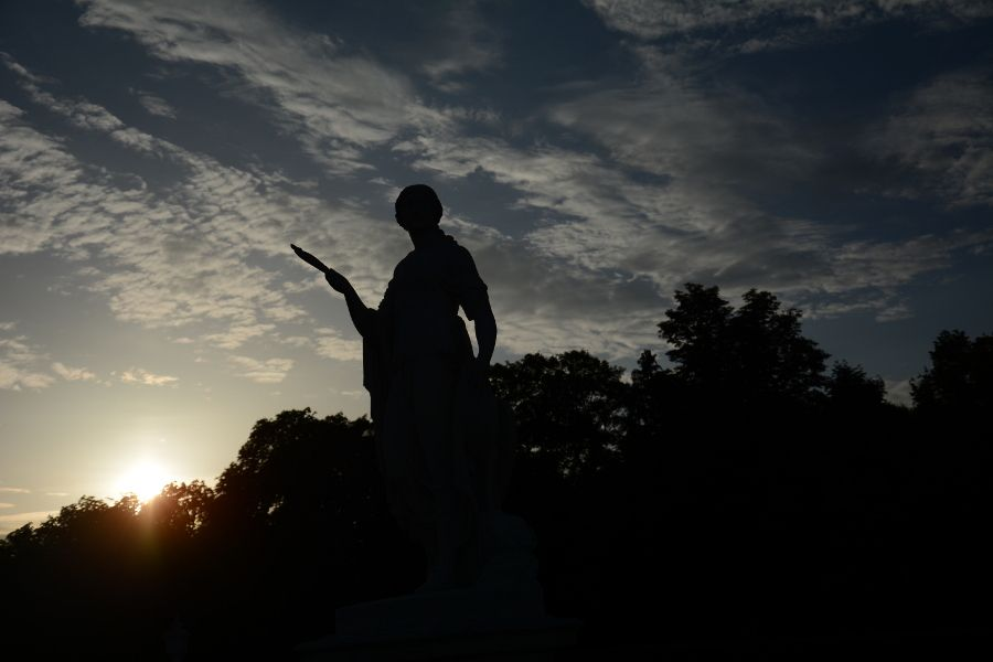 Statue at sunset at Nymphenburg Park Garden in Munich, Germany.