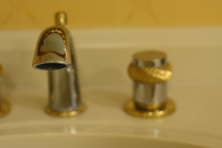 Bathroom sink faucet in a room at Hotel Du Pont.