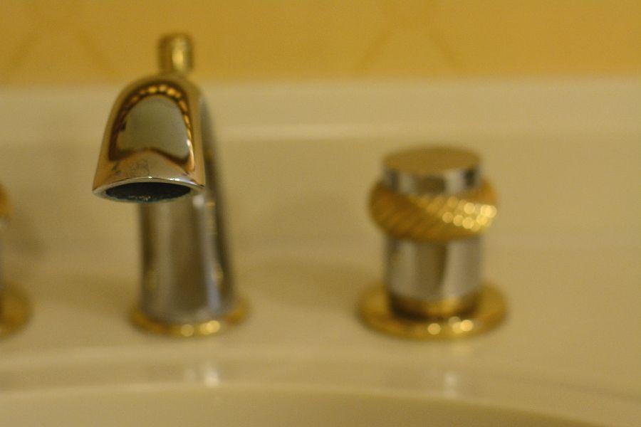 Bathroom sink faucet in a room at Hotel Du Pont.