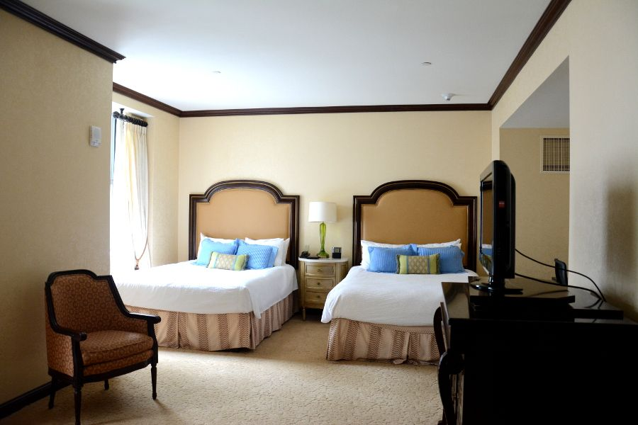 Two double beds in a Hotel Du Pont room.