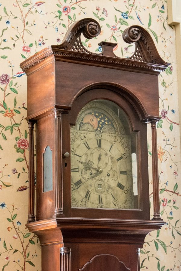 Grandfather clock and hand-painted wallpaper in the Corbit-Sharp House in Historic Odessa, Delaware.