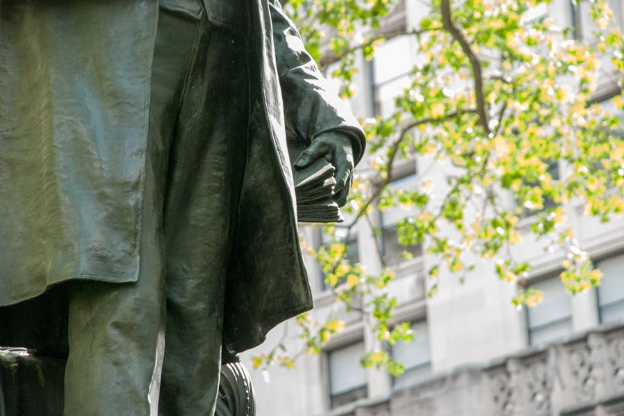 A close up of a sculpture of Chester A Arthur in Madison Square Park in New York City.