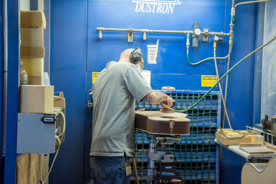 Finishing a guitar at the Martin Guitar factory.