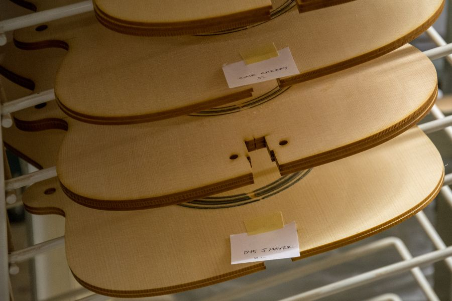 A close up of the John Mayer guitar body cutout at Martin Guitar factory.