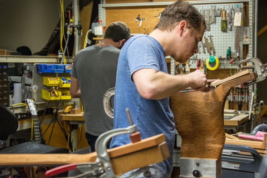 Shaping guitar necks at Martin Guitar factory.